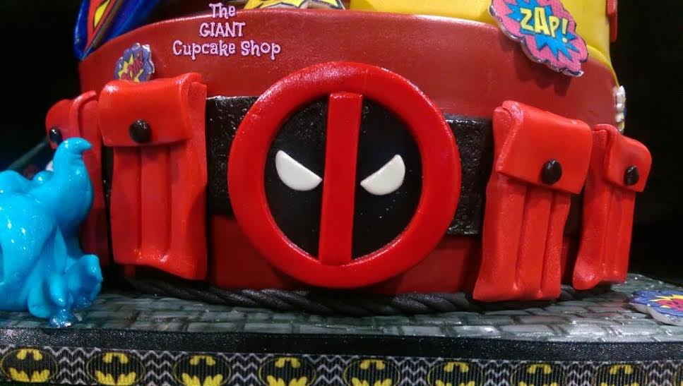 Deadpool's belt cake topper