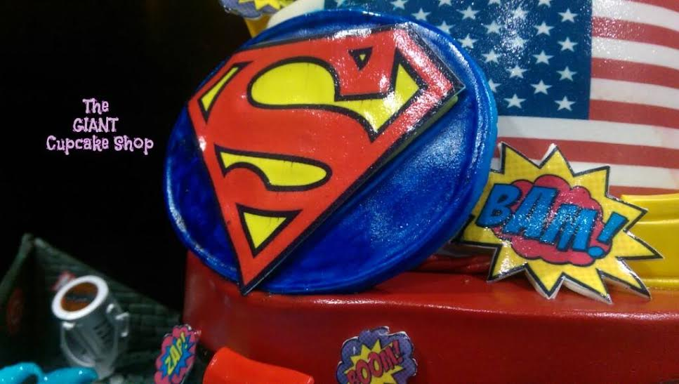 Superman's famous logo cake topper